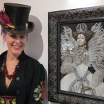 Carrie Ann Baade with her painting
